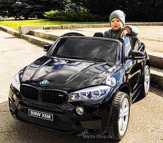 Двухместный BMW-X6-M-JJ2168 (ЛИЦЕНЗИОННАЯ МОДЕЛЬ) на резиновых колесах.