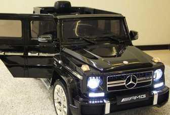 Электромобиль DMD-G63 Mercedes-Benz AMG 12V(открывающиеся дверки, резиновые колеса, амортизация).